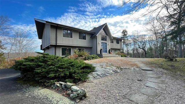 Property photo 1 featured at 135 Davis Hill Rd, Weston, CT 06883