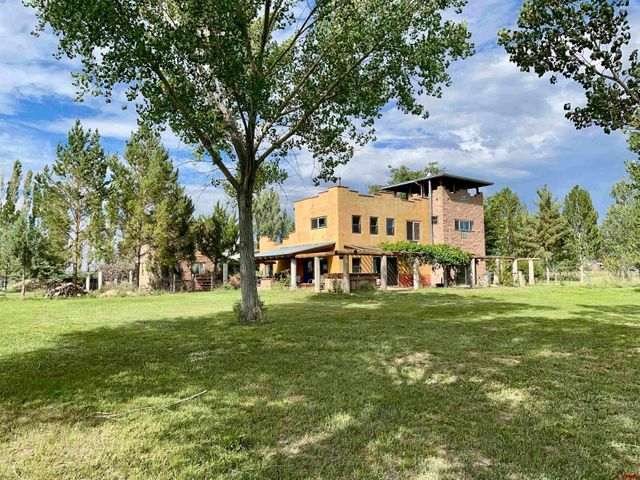 Property photo 1 featured at 10659 Road 26, Cortez, CO 81321