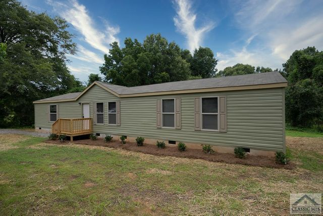 Property photo 1 featured at 1040 Riverwoods Dr, Madison, GA 30650