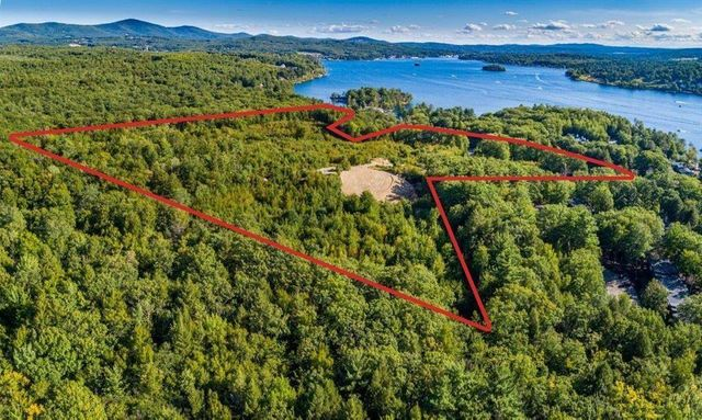 Property photo 1 featured at 713 Weirs Blvd, Laconia, NH 03246